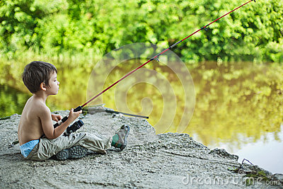 Calm child fisherman