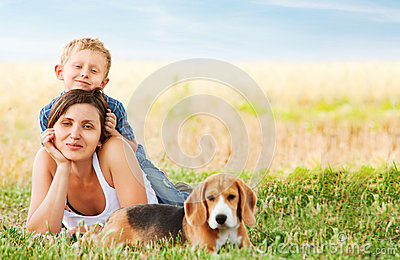 Calm family leisure scene on the meadow