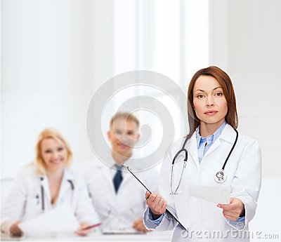 Calm female doctor with clipboard