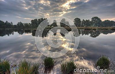 Calm lake at sunrise