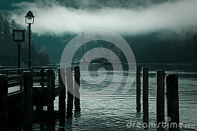Calm misty lake at down