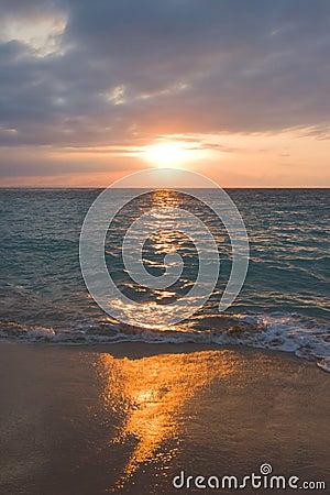 Calm ocean and beach on sunrise