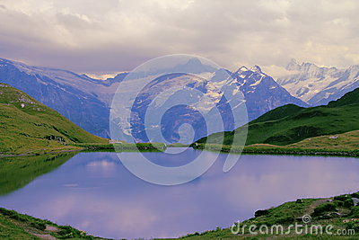 Calm pond. Eiger Mountain.