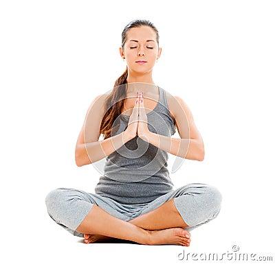 Calm pretty woman doing yoga exercise