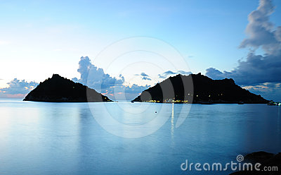 Calm sea and island at night