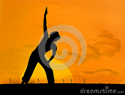Calm silhouette of woman practicing yoga