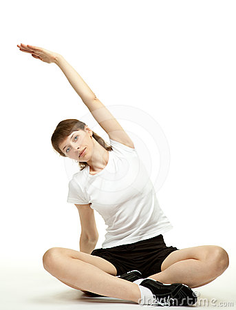 Calm young woman doing sport exercises