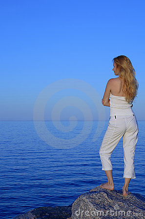 Calm young woman looking at the sea