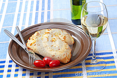 Calzone bread, tomatoes and white wine
