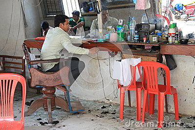 Cambodian barber waiting for clients Editorial Photo