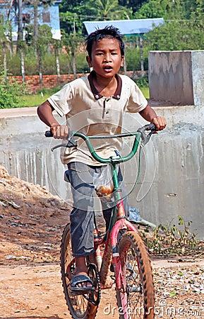 Cambodian Boy on Bike Editorial Photography