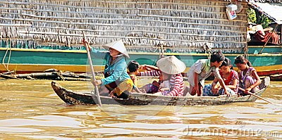 Cambodian Family on Boat Editorial Photo