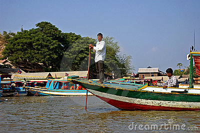 Cambodian fisherman on a boat Editorial Photography