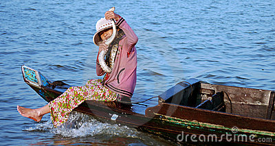 Cambodian girl (with snake) on a boat Editorial Stock Photo