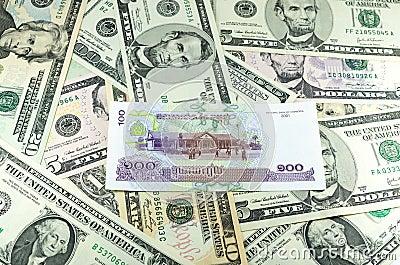 Cambodian Riel (KHR) on many dollars background