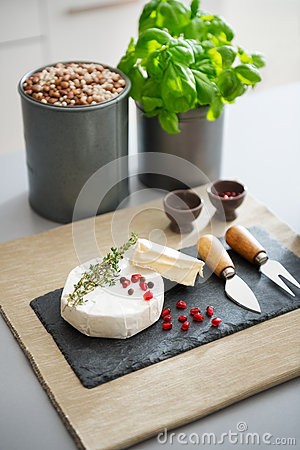 Free Camembert Cheese With Fresh Herbs, Pomegranate, And Peppercorns Stock Photos - 57060053