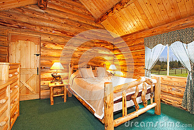 camera da letto accogliente nella casa della cabina di