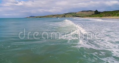 The camera flies over the waves in the ocean against the backdrop of the hills. Shevelev. stock footage