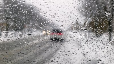 Rain water drops on the windshield in a rainy day stock video
