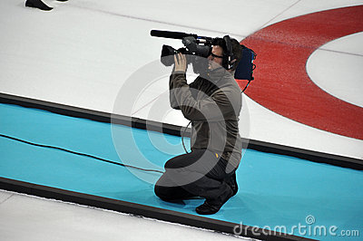Camera man at XXII Winter Olympic Games Sochi 2014 Editorial Stock Photo