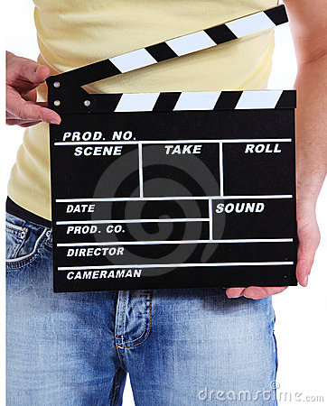 Camera operator holding clapperboard