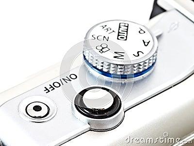 Camera shutter and program selective wheel