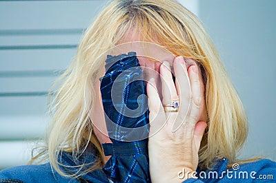 Camera shy blonde