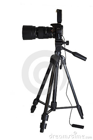 Camera on tripod isolated