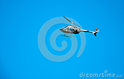 Camouflage Bell 206 helicopter
