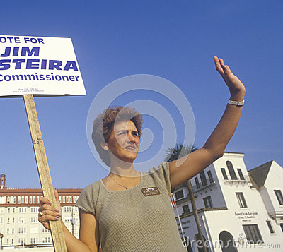 A campaign volunteer holding a sign Editorial Image