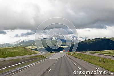Camper on overcast highway