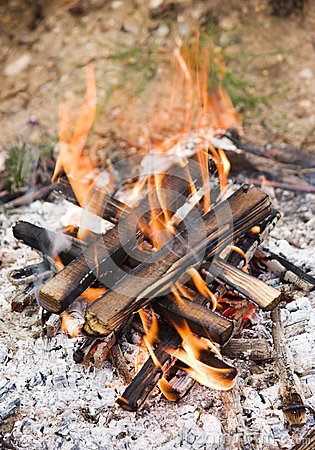 Camping bonfire with ash