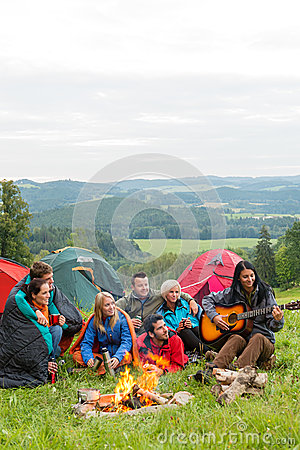 Free Camping Friends Playing Guitar Beside Fire Nature Stock Image - 29932631