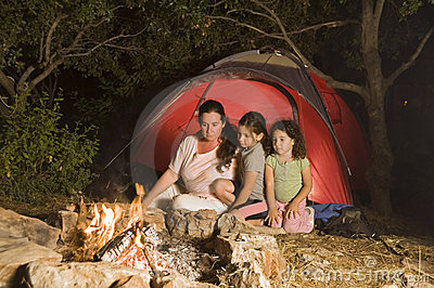 Camping mother and daughters