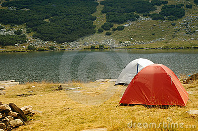 Camping tents near a mountain lake