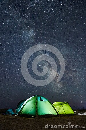 Free Camping Under The Stars With Green Illuminated Tents, Visible Milky Way Galaxy, Clear Sky, Long Exposure Royalty Free Stock Image - 103806376