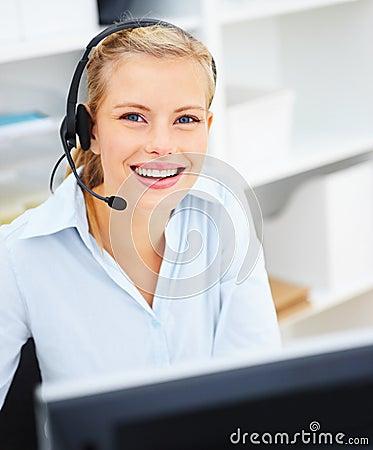 Can I help you? - Joyfull woman using headset