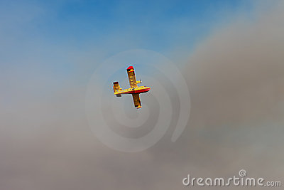 Canader fights fire Editorial Stock Image