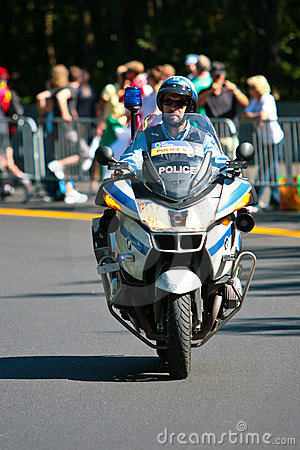Canadian Police Officer on a motor bike Editorial Photography