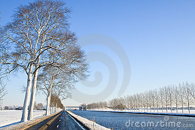 Canal in a cold white winter landscape