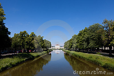 Canal in between lines of trees