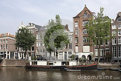 Canal scene with houseboat, Amsterdam