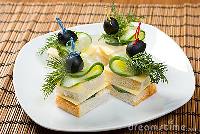 Canape with cheese and cucumber.