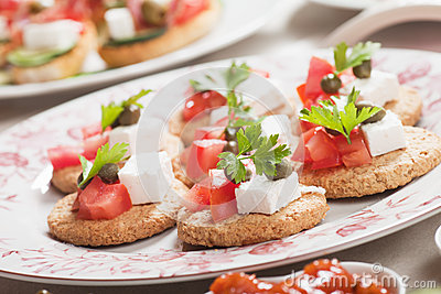 Canape with tomato and feta cheese
