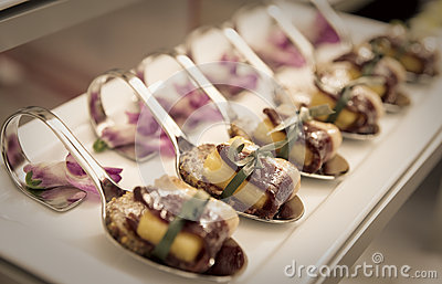 Canapes with cured ham on banquet table