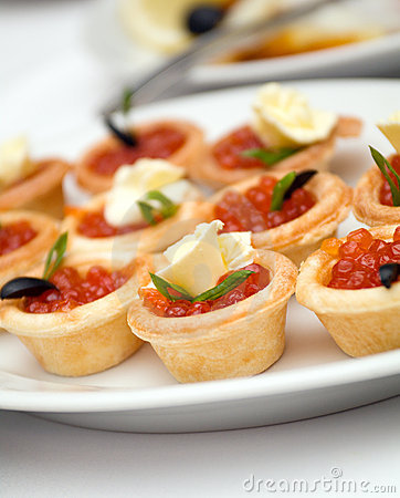 Canapes with red caviar   .