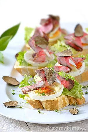 Canapes with roast beef and truffles stock photo image for Roast beef canape