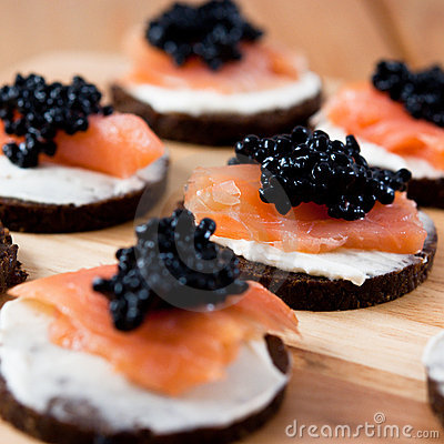 Canapes with salmon and caviar royalty free stock for Canape de caviar