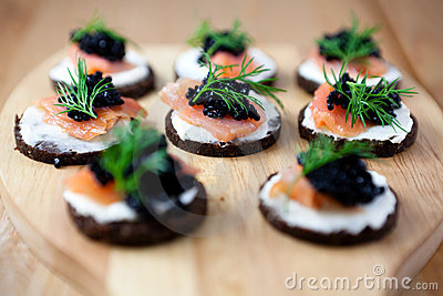Canapes with salmon and caviar royalty free stock for Canape de salmon