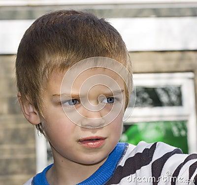 Candid close up portrait of a boy